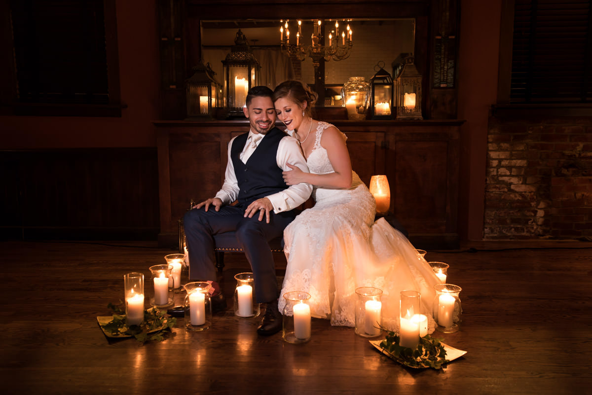 A couple on their wedding day, surrounded by candles at The City Cottage, St Louis